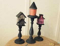 cute bird houses on candle holders and covered with scrapbook paper
