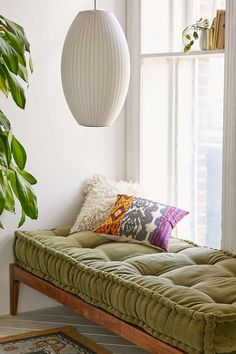 George Nelson Cigar Pendant Light and Velvet Cushion - Urban Outfitters