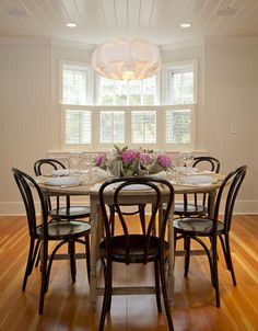 Refinished old table and mismatched chairs = elegance