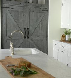 Kitchen prep sink. Kitchen prep sink and faucet. The island prep sink is a great addition to this kitchen and is used more frequently than the larger sink, simply because it is conveniently located near the refrigerator and range. #kitchenprepsink #prepsink #faucet Beautiful Homes of Instagram @SanctuaryHomeDecor