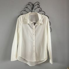 Boutique White Studded Collar Blouse NWOT. Never worn, just tried on. No flaws other than it need a little ironing hehe. Has silver studs on the collar and an opening in the back. Let me know if you have any questions!! Make me an offer!! Boutique Tops Blouses