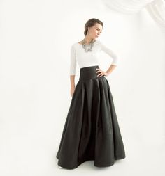 Our black taffeta ball gown skirt sits high at your waist, smooths over upper hips and flares elegantly down to the floor. Made out of light-weight, crisp, and lustrous taffeta this floor length skirt is a real show-stopper that would make you want to walk across that room and turn a few heads. Cheers to the prettiest woman at the party!  TURNAROUND  This dress will be expertly and lovingly handmade in our own studio in New York City to your order within 3-4 weeks. Occasionally, we are able…