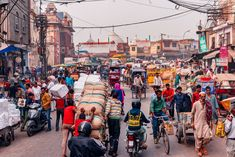 A bustling scene before the spice market opens for the day in Khari Baoli