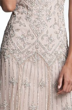 This is a closeup of my wedding dress. It is more beige/champagne than in this picture which looks a little pink. Definitely not pink. I don't want to show the whole thing because... well, some things are better 'experienced'.