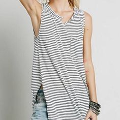"HP Free People Weekend Warrior. This tops puts you in the mood for a great weekend surrounded by friends and filled with fun. Super relaxed and loose fit. It's a size M but possibly would fit an L. Shoulder to hem is 30.5"". 17"" from shoulder to shoulder. Hem is 26"". Free People Tops"