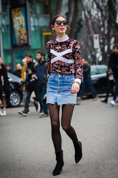 A floral sleeved top is worn with a denim skirt, black stockings and black pointed boots