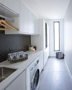 These large floor tiles are the piece-de-resistance of this stylish laundry . Modern Laundry Rooms, Laundry In Bathroom, Laundry Room Organization, Laundry Storage, Laundry Nook, Large Floor Tiles, Grey Floor Tiles, Black Tiles, Laundry Room Inspiration