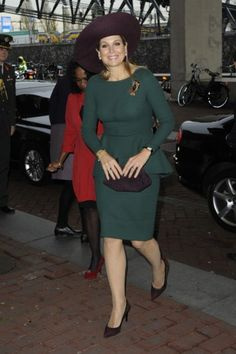 The queen in a green peplum dress. Click on the image to see more looks.