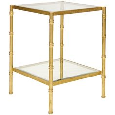 "Worlds Away bamboo side table with clear glass tops. Details: - Available two gold and silver colors - Glass top Dimensions: - Overall: 20"" w x 26"" h x 20"" d"