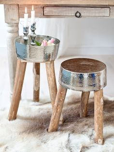 Fabulous rustic wooden stool with a twist.....!     The magnetised metal top has a hammered finish and can be turned upside down into a tray, to turn the stool into a handy contemporary side table for holding decorative accessories such as a vase, plants, candlesticks, lanterns or hurricane lamps.