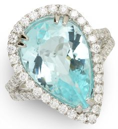 Need 'Something Blue' for your wedding look? How about this brilliant blue tourmaline ring? 6.84 ct Paraiba Copper Bearing Tourmaline & 1.09 ctw Diamond 18K White Gold 6.49gr Ring Size 6.75