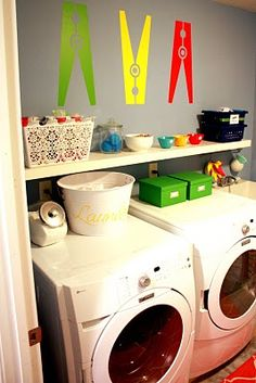 Clothes pins are so cute for laundry room decor. I like the decorative basket to hold the laundry additives.