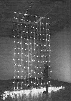 wall of hanging lights. Art. Black and white photography. Wedding reception inspiration.