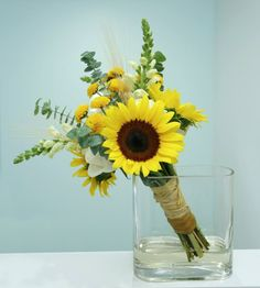 Beautiful bouquet. Made with sunflowers, white roses, eucalyptus and wheat.