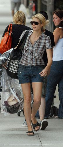 Heidi Klum is seen carrying her wardrobe and saying goodbye to her family on the sidewalk outside her NY apartment