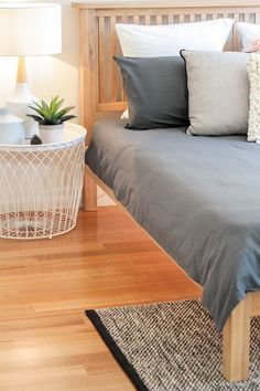 neutral tones grey linen timber bed frame bedroom styling