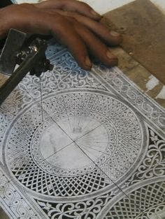 Close up photo of metal work in Yahya's workshop. The exquisite detailing is executed by hand and sawn with tiny jewellery saws.