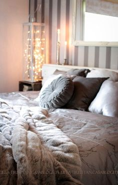 Bedroom - love the light. I think it's just a lantern with fairy lights? very cool