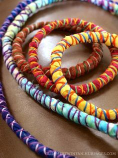 How to Make Fabric-Wrapped Cord Necklace or Bracelet. Wear them separately or all together for a fun and funky look. These fabric wrapped cord bracelets and necklaces jazz up any outfit! Fabric Bracelets, Fabric Necklace, Cord Bracelets, Embroidery Bracelets, Diy Necklace Cord, Braided Necklace, Kids Necklace, Necklace Tutorial, Bangles