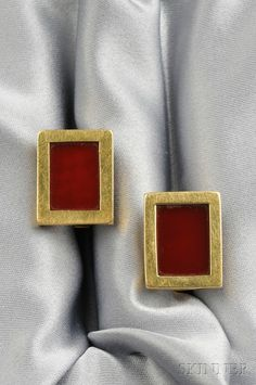 18kt Gold and Carnelian Cuff Links, Tiffany & Co., each carnelian tablet within a rectangular bezel, maker's mark for Larter & Sons, signed.