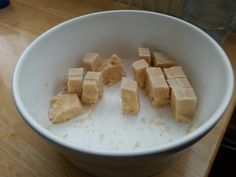 Fake Fudge, SYN FREE!  Okay, so this isnt fudge, but it does look like fudge and it was something different for me to snack on. It's frozen toffee Muller light and very roughly mashed banana with some extra sweetener. Once frozen, i took it out of the freezer and left it for 20 mins then sliced it into cubes (ice cube size) and voila! My 4 year old daughter and i enjoyed it very much.