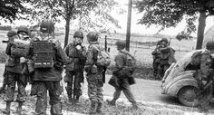 the 505th Regimental Staff arrives at Groesbeek, Colonel William E. EKMAN, CO 505th PIR (facing camera) and Lt. Colonel Edward C. KRAUSE, XO 505th PIR, discuss the situation …