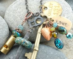 Vintage skeleton key with boro glass love necklace.