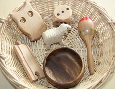 """Counting Coconuts: Treasure Basket: Wood. I like the idea of having a """"what's it made of tray"""". So many children don't know the different materials that objects in thier world are made of."""