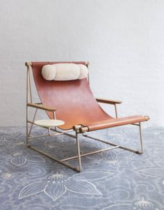 May I introduce you to the most stunning piece of furniture you never knew you needed? This gorgeous chair, with its simple leather seat, bronze frame, shearling pillow and wooden tray, is the brainchild of designer Tyler Hays of BDDW. It's a work of art Leather Furniture, Furniture Projects, Furniture Decor, Furniture Design, Outdoor Furniture, Furniture Stores, Furniture Movers, Leather Chairs, Wicker Furniture