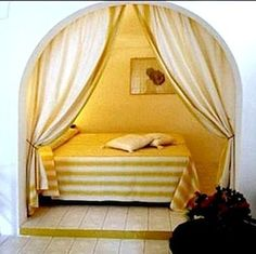 Create a room within a room and hang curtains instead of a door.