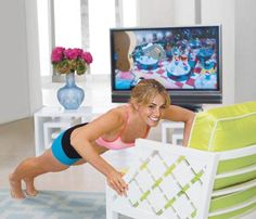 How to Workout While Watching TV  Glued to the tube? You're not alone. American women spend, on average, more than five hours a day watching TV. Which made us think: What if you could use some of that prime time to fight flab? Here, Smallville actress Erica Durance shows you how to get into superhero shape without missing your favorite shows.