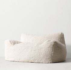 RH TEEN's Berlin Lounge Sherpa Chair:The next-generation bean bag. Our collection's body-conforming foam-and-bead insert ensures classic sink-in comfort, while the raised back and arm rests add an element of support to its relaxed silhouette.