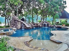 Inground swimming pool with waterfalls and slide and beach access.my dream pool. Ideas De Piscina, Platinum Pools, Living Pool, Outdoor Living, Pool Waterfall, Backyard Paradise, Paradise Garden, Beautiful Pools, Dream Pools