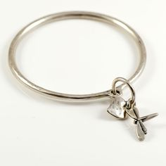 Danon Silver Bangle With Dragonfly And Heart Charm. View here http://www.lizzielane.co.uk/shop/danon-silver-bangle-with-dragonfly-and-heart-charm. £22