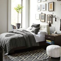 I don't really care for the bed or the sheets but I LOVE the pictures and the accordion lamp - West Elm Bedroom