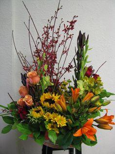 Event flowers, event centerpieces, fall centerpiece, corporate dinner flowers, lilies, calla lilies