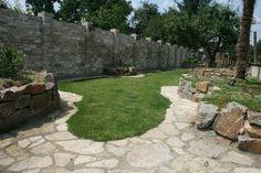 Unieke tuin met flagstone tegels, door Natuursteen Meterik.
