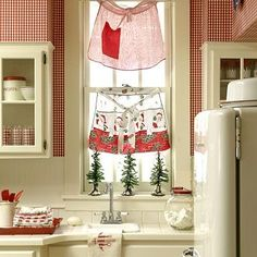 Seasonal Kitchen Sink Red and White kitchen with vintage apron curtains (aprons)