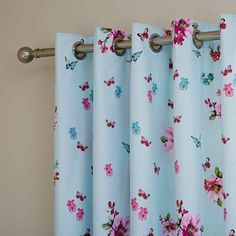 Featuring a Chinese-style butterfly and flower design in shades of pink and blue on a light blue background, these eyelet curtains are crafted from a super soft...