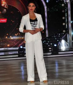 Priyanka Chopra was smart in a white Armani linen suit with a black tank top on sets of Jhalak Dikhhla Jaa 7. #Bollywood #Fashion #Style #Beauty