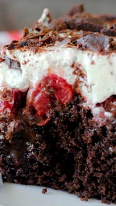 Black Forest Poke Cake ~ A gooey chocolate cake filled with hot fudge and cherry pie filling. It is topped with fresh whipped cream and chocolate shavings.