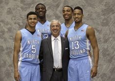 UNC coach Roy Williams poses with Marcus Paige, Joel James, Brice Johnson and J.P. Tokoto before the 2014-15 season