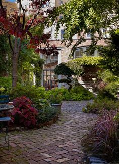 Shaded brick patio with tall plantings around it H. City Residence with Gardens - industrial - patio - philadelphia - Hanson General Contracting, Inc.