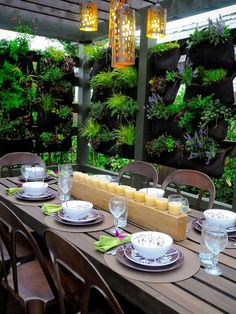 Vertical walls of plants in pockets create privacy for this outdoor dining room.