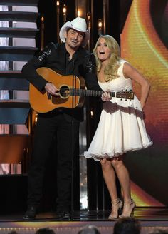 Carrie Underwood Photos - Hosts Brad Paisley and Carrie Underwood speak onstage during the annual CMA awards at the Bridgestone Arena on November 2014 in Nashville, Tennessee. - Annual CMA Awards - Show Carrie Underwood Cma, Carrie Underwood Pictures, Celebrity Couples, Celebrity Gossip, Celebrity News, Country Girls, Country Music, Country Singers, Cma Awards