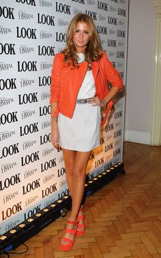 Pin for Later: All the Made in Chelsea Girls' Finest Fashion Moments  At LOOK magazine's birthday party in March 2012, Millie chose acid brights, with an orange biker jacket and matching sandals over a white dress.