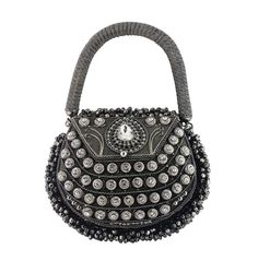 A fantabulous Purse with a touch of glamour & style from Arte Sia. Arte Sia - a brand for luxurious jewellery has come up with a very unique range of products. Go ahead & make a style statement. Shop on www.siajewellery.com or in Sia Art Jewellery store. @Sia Art Jewellery