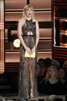 For last night's 2016 CMAs, Taylor Swift, who hasn't attended the awards show since 2013,  wore an embroidered graphic cut out gown from Julien Macdonald's spring/summer 2017 collection.