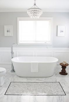 Cool and calm master bathroom with a little bling