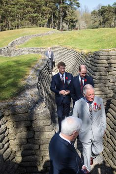 Prince Harry Photos Photos - (L-R) Prince Harry; Prince William, Duke of Cambridge and Prince Charles, Prince of Wales are taken on a tour of the preserved trenches at Vimy Memorial Park on April 9, 2017 in Vimy, France. The Prince of Wales, The Duke of Cambridge and Prince Harry along with Canadian Prime Minister Justin Trudeau and French President Francois Hollande attend the centenary commemorative service at the Canadian National Vimy Memorial. The Battle Of Vimy Ridge was fought during…